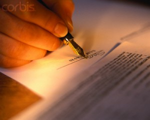 Signing a Contract --- Image by © Kathy Collins/Corbis
